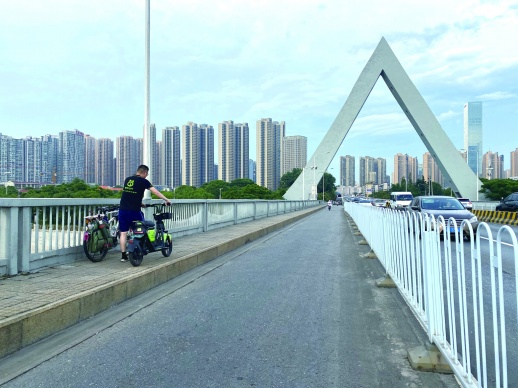 长沙电动助力车一上桥就断电?电动助力车企业:着手扩增骑行区域