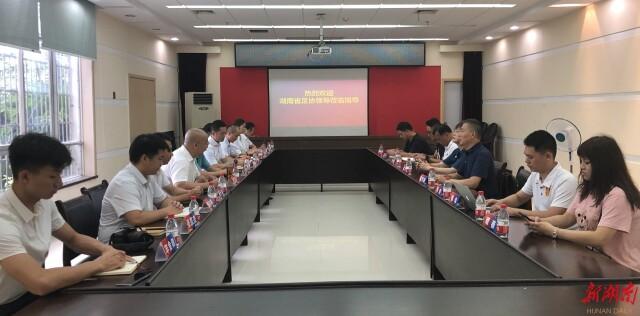 共推省级体育协会高质量发展 省足协在省跆协互动交流
