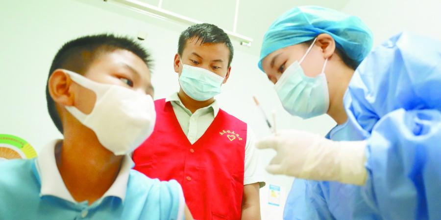 暖心志愿服务 助力疫苗接种